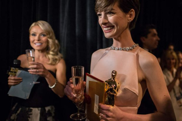 Actress Anne Hathaway backstage following her win for the Best Actress.