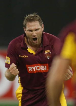 Success: Ryan Harris claims a wicket.