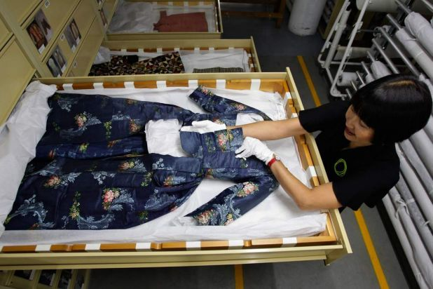 Conservator of Costumes Textiles and Dress, Suzanne Chee, shows an 18th century open robe.