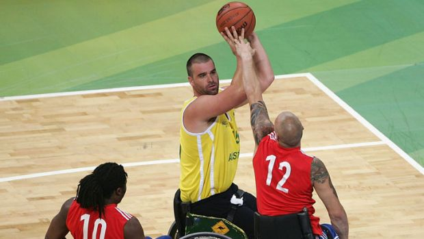 Great Britain's team tries to block Brad Ness of Australia in the semi-final match of Basketball between Australia and ...
