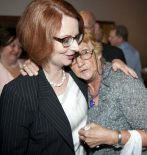 Veronica Voigt, from the flood-affected town of Laidley, embraces Julia Gillard during the Prime Minister's visit to ...