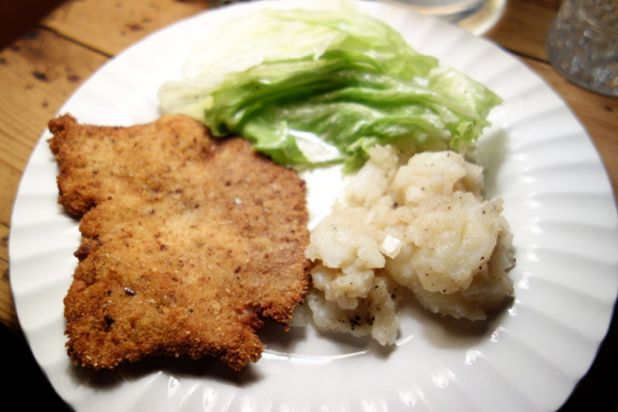 Pork schnitzel, warm potato salad and lettuce at Café Mueller.