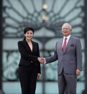 The deal is done  ... Shinawatra and Razak outside Razak's office.