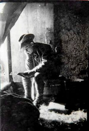 Private George Griffin in a barn in France with his diary.