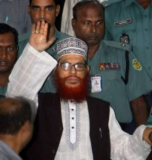 Bangladeshi police officers escort Delwar Hossain Sayeedi, centre. A special war crimes tribunal in Bangladesh sentenced ...