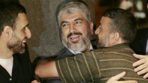 Khalid Mishal greets two Palestinian prisoners released from an Israeli jail in 2011.
