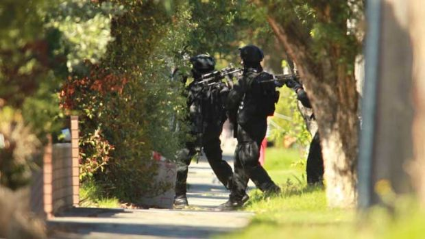 Police enter the ground the house in Glenroy.