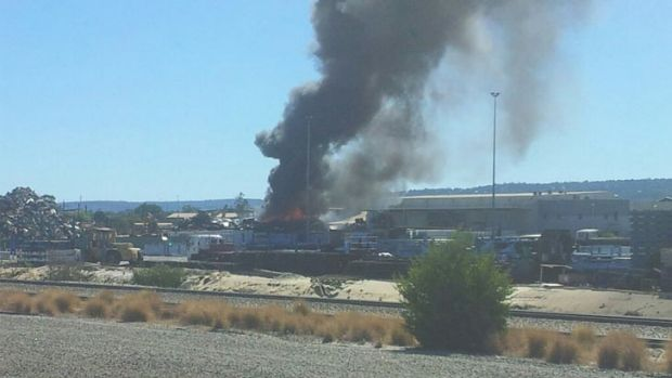 Up to 200 cars are on fire at the steel factory in Perth's east.