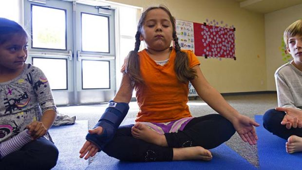 Classroom peace: First-grader Miriam Ruiz practises her yoga at a school in Encinitas, California.
