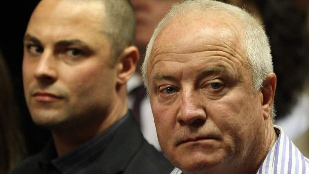 'It speaks to the ANC government' ... Henke Pistorius, right, and his son Carl during the bail hearing for Oscar ...