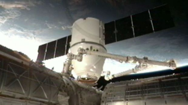 The SpaceX Dragon anchoring to the International Space Station.