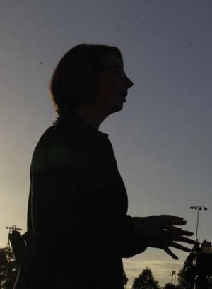 Twilight zone: Julia Gillard does a live TV cross from Blacktown Olympic Park on Monday.