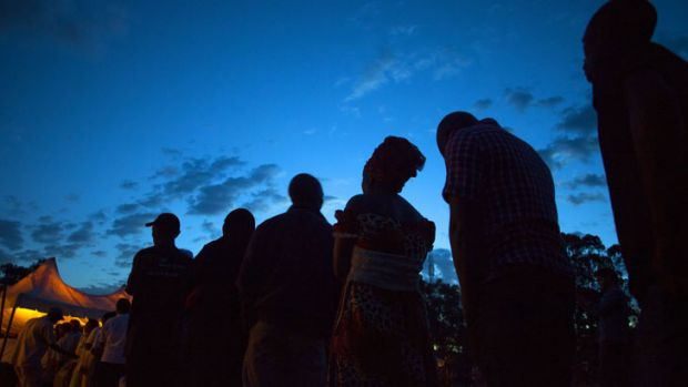 Voters stand in line at the Kibra Social Grounds polling station in Nairobi on March 4, 2013 during the elections.