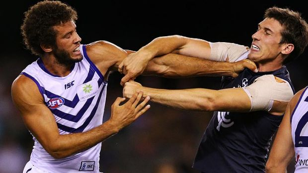 Zac Clarke (left) limped out of Fremantle training on Tuesday morning and is in doubt for Saturday's season-opener.