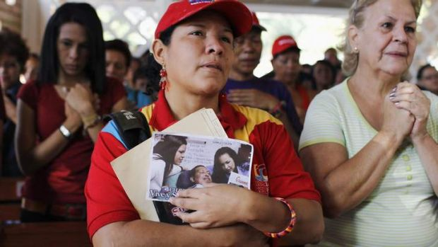 Supporters of Venezuelan President Hugo Chavez pray in a chapel outside the Caracas military hospital in Caracas.