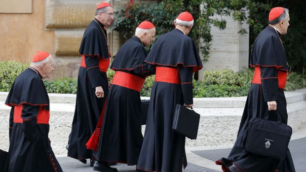 Cardinals arrive for a meeting at the Synod Hall in the Vatican on March 5, 2013.