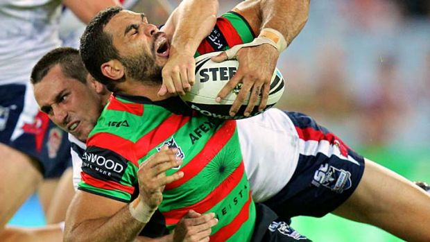 Mitchell Pearce grapples with Greg Inglis during last year's clash at ANZ Stadium.