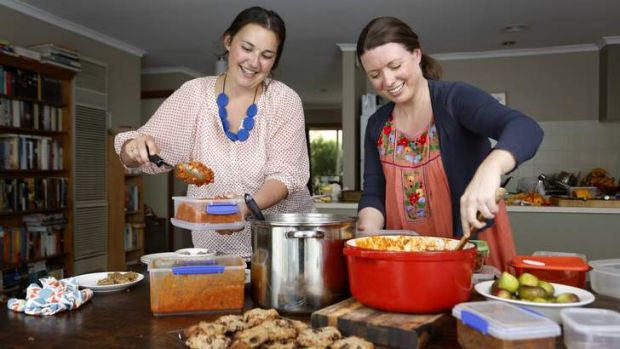 Laura Giltrap from Ainslie, left,   and Canberra MamaBake community manager Karen Swan.