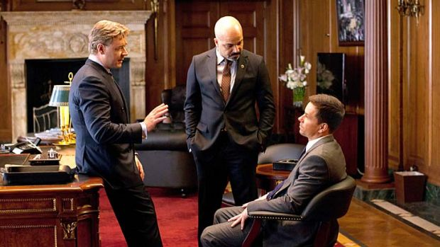 Russell Crowe (left) and Mark Wahlberg (seated) in Broken City.