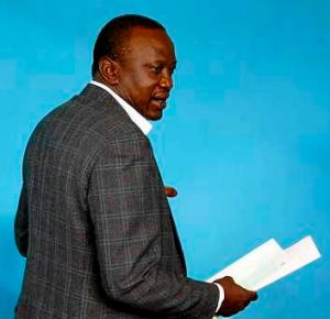 Kenya's Deputy Prime Minister and presidential candidate Uhuru Kenyatta casts his ballot.