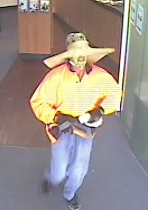 Police are searching for this man who robbed a Carina bank on Wednesday.