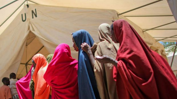 Lifeline ... women for medication outside a tented-pharmacy in Mogadishu, operated by the African Union Mission in Somalia.
