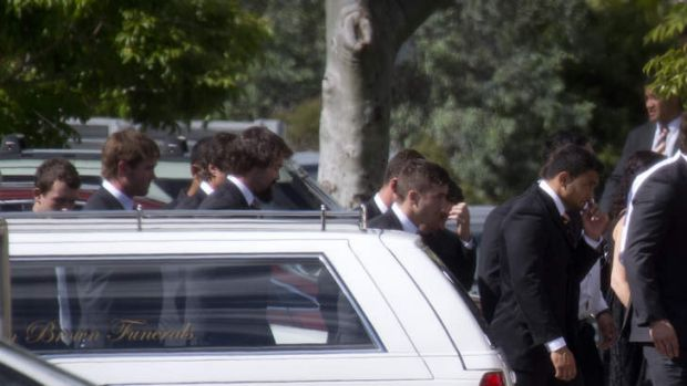 Wests Tigers players and staff enter the funeral of Mosese Fotuaika, held in Cleveland, east of Brisbane.