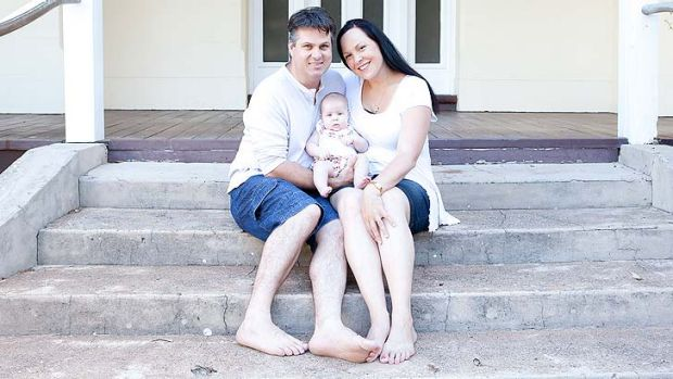 Alanna and Ray Mell with their daughter Charlotte.