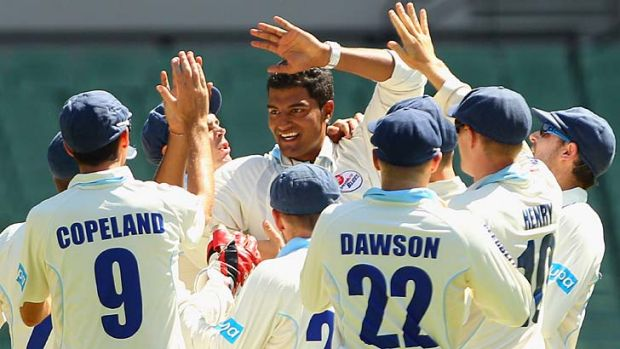 Gurinder Sandhu is all smiles after removing Cameron White.