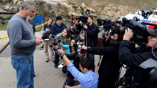 Cat Haven founder Dale Anderson cried as he reads a  statement to the media.