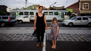 Academic and chef Helen Addison-Smith with daughter Tallulah, 7, on Lygon Street, Brunswick.