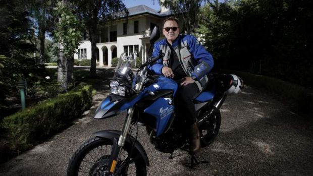 Tim Mathieson will be riding a BMW from Kirribilli House to The Lodge to raise funds for a Cambodian orphanage combating ...