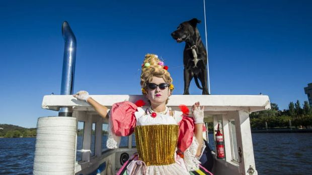 Centenary performer, Madame Bon Bon and Josie the dog, on board the Blue Fin boat on Lake Burley Griffin.