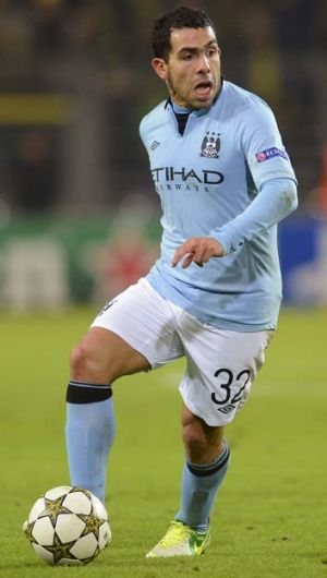 Carlos Tevez has been arrested on suspicion of driving while disqualified.