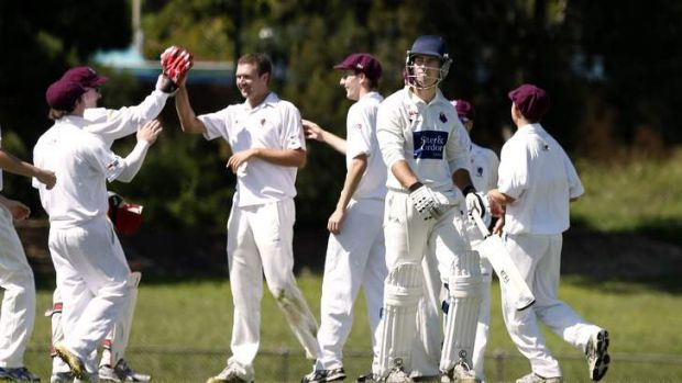 Wests/ UC players celebrate after Eastlake batsman Adam Tett, 2nd on right, is caught out during the match at Jamison Oval.