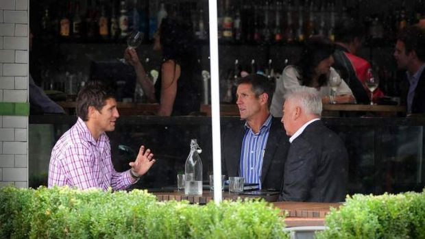 Josh Dugan's manager Paul Sutton meets with Raiders chief executive and Raiders board member Terry Weber last February. ...