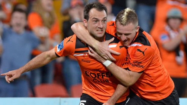 Ivan Franjic of the Roar celebrates with team mate Besart Berisha after scoring Brisbane's lone goal against Melbourne ...