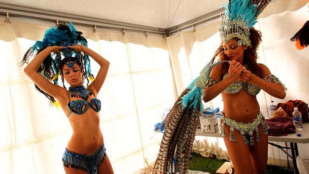 Let the feathers fly: Sequinned Brazilian dancers prepare backstage for the finale of the Autumn Vibes Festival.