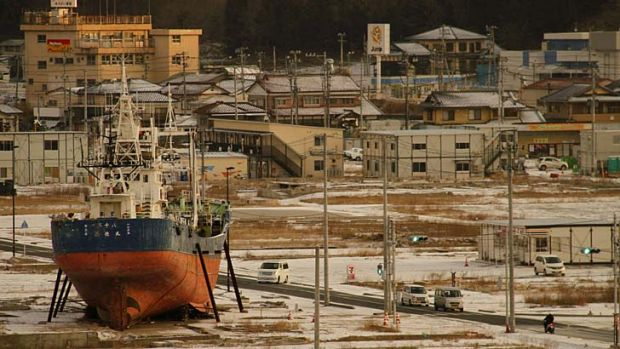 Permanent reminder: a fishing boat washed ashore by the tsunami sits in a deserted port area in Kesennuma, Miyagi ...