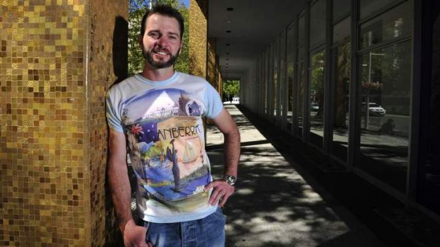 Aaron Chandler shows off his vintage Canberra T-shirt.