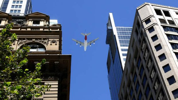 Qantas salute: An A380 superjumbo flies over Sydney's CBD in a tribute to James Strong.