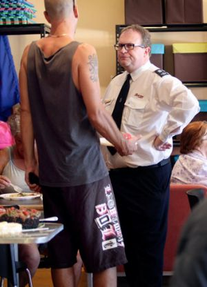 A Salvation Army worker has a chat.