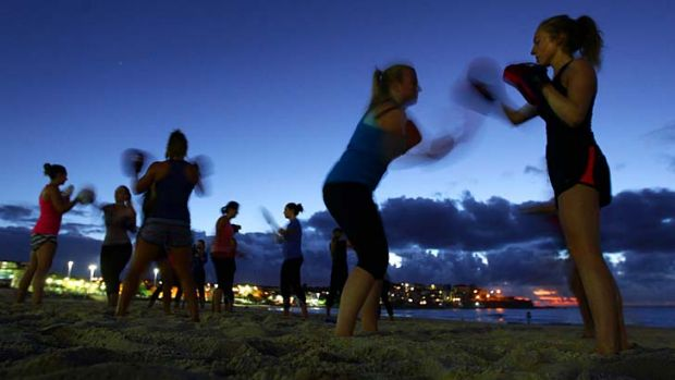 Training day: Bottoms Up! fitness groups exercise on Bondi Beach.
