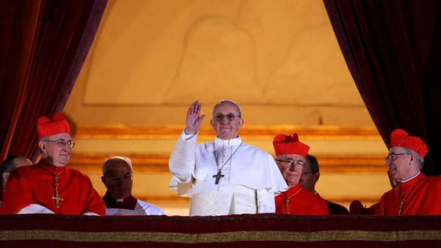Jesuit: newly-elected Pope Francis I appears on the central balcony of St Peter's Basilica.