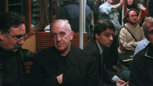 In this 2008 photo, the new Pope Jorge Mario Bergoglio, second from left, travels on public transport in Buenos Aires, ...