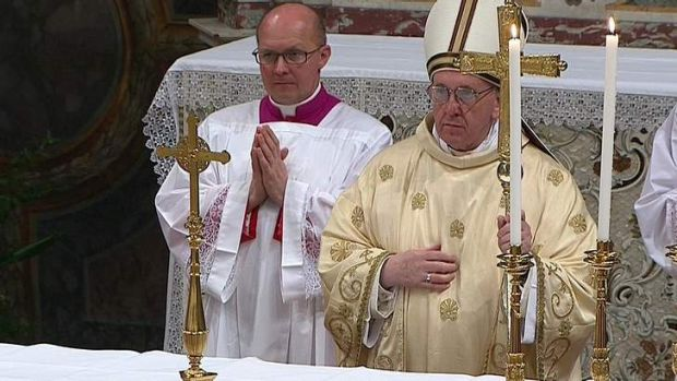 Newly elected Pope Francis I, Cardinal Jorge Mario Bergoglio of Argentina, leads a a mass with cardinals at the Sistine ...