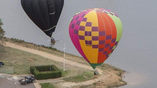 A balloon lands in Lake Burley Griffin this morning.