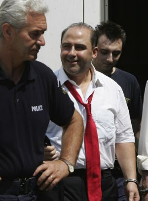 Making a federal case out of it: Tony Mokbel, escorted by Greek police, leaves a court in Athens in 2007.