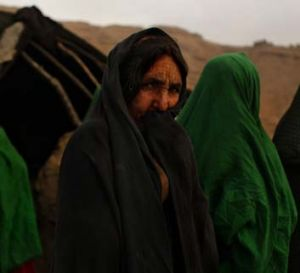 What future? Afghan Kuchi woman Sarwara (second from the left) surrounded by female relatives in front of their ...