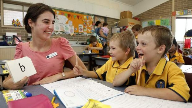Covenant College Kindergarten and Year 1 teacher Evie Stubbs does a phonics exercise with kindergarten students Ethan ...
